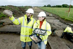 Archaeologists Oliver Cooper and Cath Ambrey with some of the Roman finds
