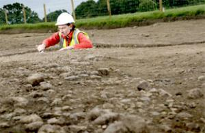 Cath Amrey works on a cross section dug across the Roman road